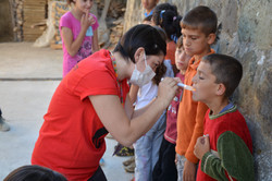 Founder Alba examining the children