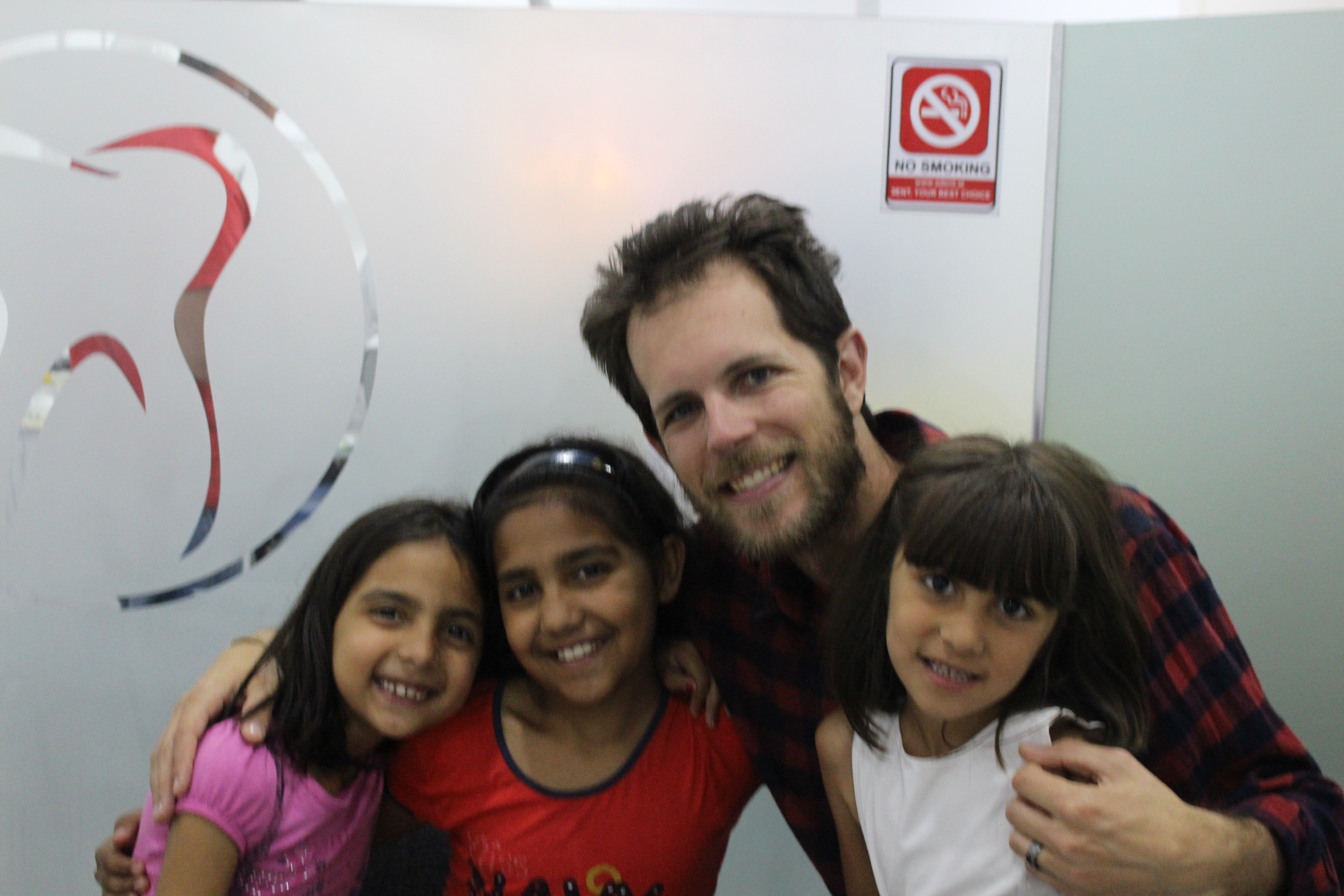 Founder Joey& the children at clinic