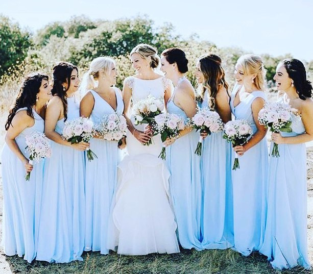 Victoria Hair stylist wedding bridal party laughing in blue dresses