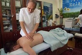 Dr_David_Tio_w_patient_04-300x201.jpg
