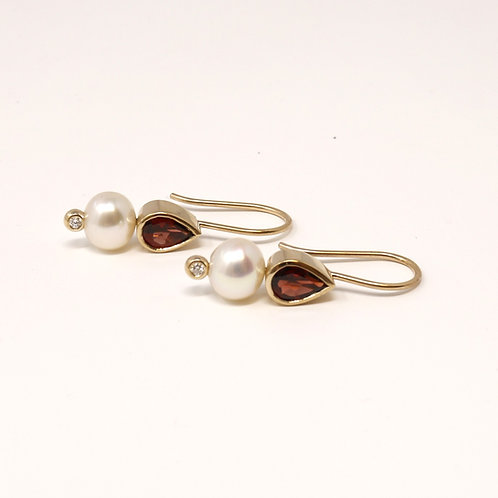 Wong Ken's Pearl and Garnet Earrings