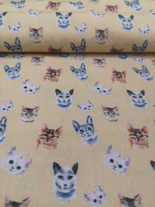 Cat Heads Printed On To Yellow Cotton Fabric