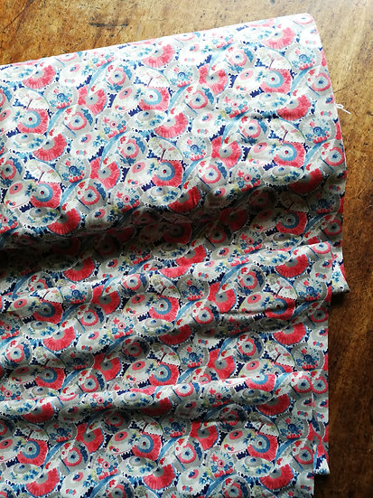 Pima cotton lawn dressmaking fabric with parasols in red