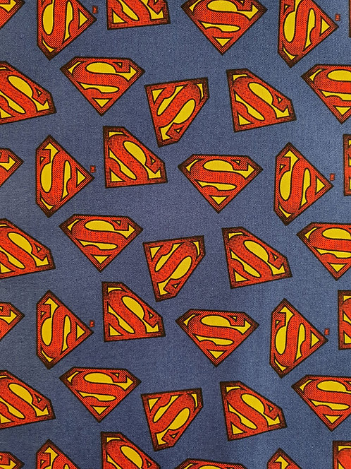 Superman Logo Printed On To A Blue background On Cotton Fabric