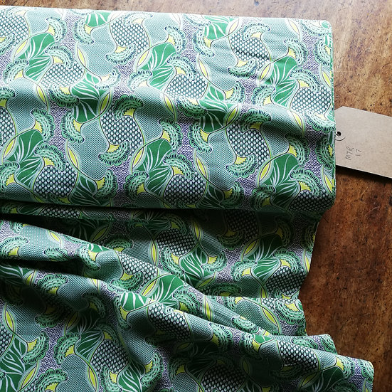 Tencel fabric with a leaf print in green and yellow