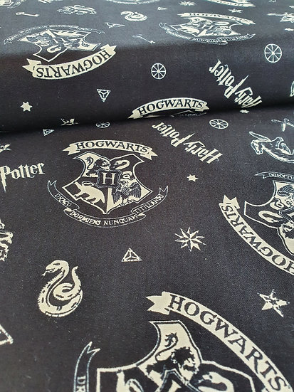 Harry Potter Hogwarts Badge Printed Onto A Black Background Of Cotton Fabric