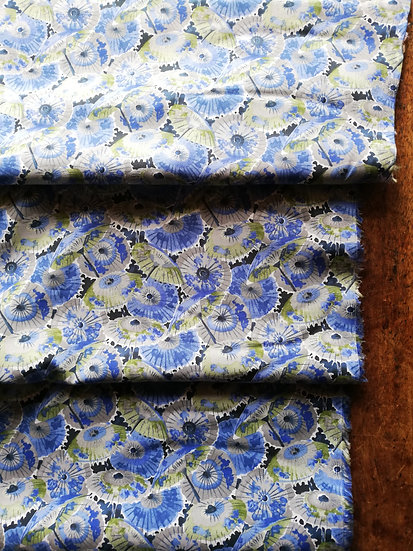 Pima cotton lawn dressmaking fabric with parasols in blues and greens