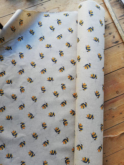 Heavy weight cotton mix home decor fabric with a digital bumble bee print on a linen colour background