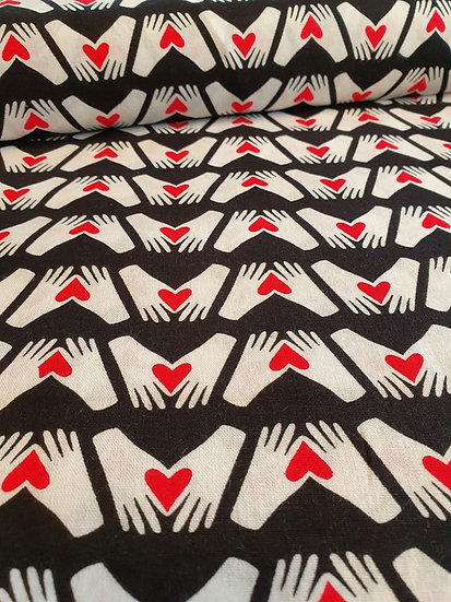 Black Cotton Fabric With White Hands And Red Hearts Printed On