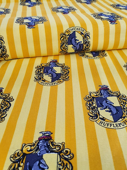 Harry Potter Striped Yellow Print Background With A Hufflepuff Badge Printed On It
