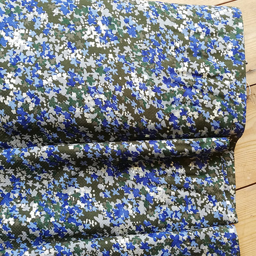Viscose dressmaking fabric with a blue and green which has subtle metallic silver touches