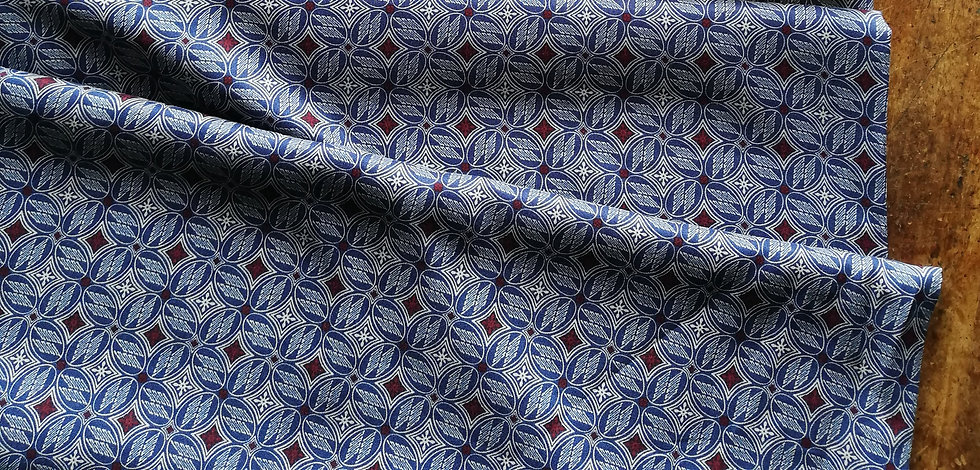 Viscose crepe dressmaking fabric with a art deco tile design printed on blues and burgundy