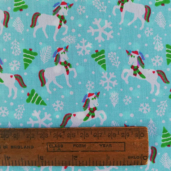 Christmas Unicorns On A Aqua Coloured Background Printed On To Polycotton fabric
