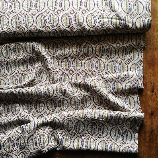 Viscose challis dressmaking fabric with a filigree/abstract leaf design