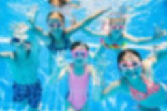 little kids swimming  in pool  underwate