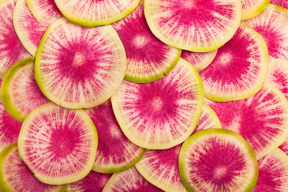 green pink and white discs, radish slices