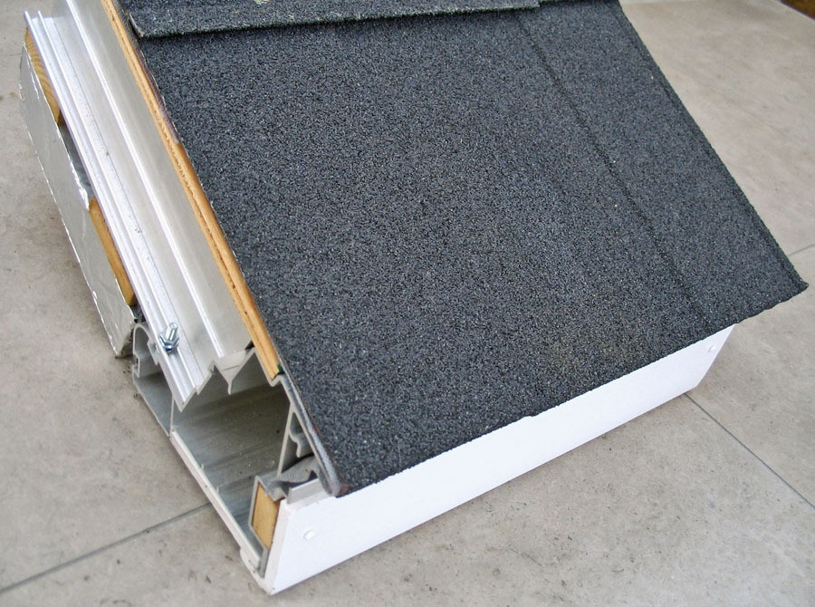 steel tile mounted on demo roofing section