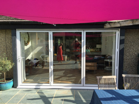 Installation of Smart Systems aluminium bi-fold doors – before and after