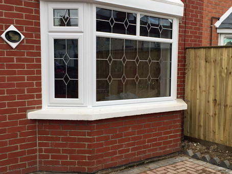 Bay window installation with Queen Anne leaded glass