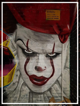 Pennywise, outdoor mural at an art festival