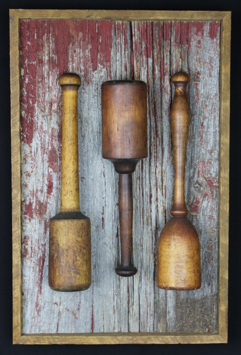 antique kitchen pestle mashers mounted on circa 1870s barnboard