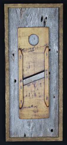 antique small food slicer mounted on circa 1870s barnboard