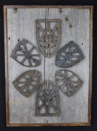 antique iron holders mounted on extra wide circa 1870s barnboard