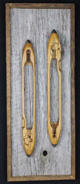 vintage textile spindles mounted on circa 1870s barnboard