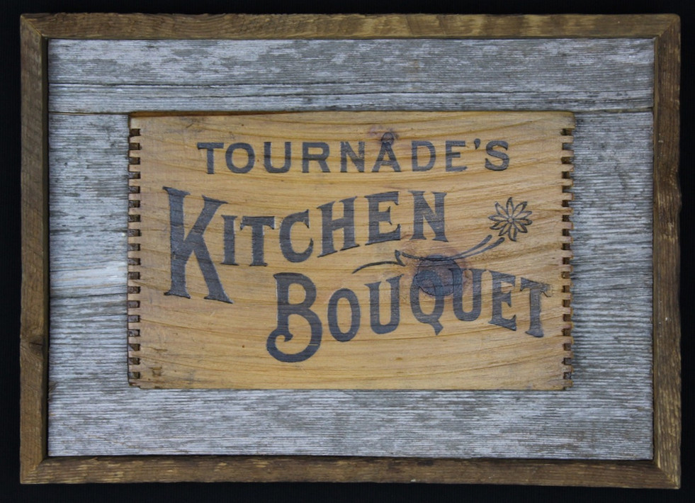 antique wooden box sign mounted on circa 1870s barnboard