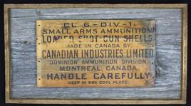antique shipping box sign mounted on circa 1870s barnboard