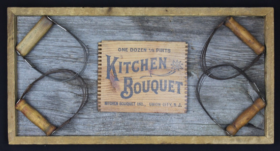 antique box label surrounded by antique mashers & mounted on circa 1870s barnboard