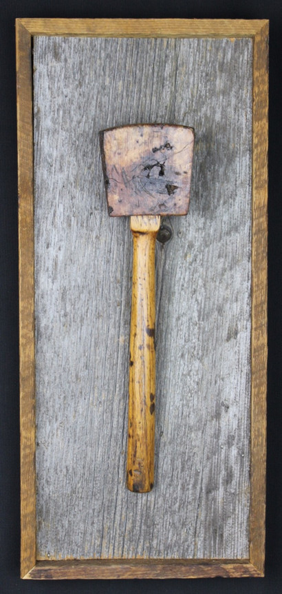 antique carpenters mallet mounted on circa 1870s barnboard
