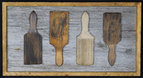 antique butter paddles mounted on circa 1870s barnboard