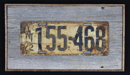 vintage 1922 Ontario licence plate mounted on circa 1870s barnboard