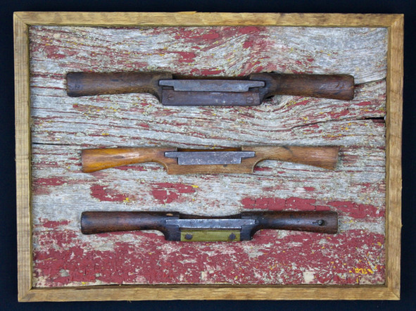 antique spokeshaves mounted on circa 1870s barnboard