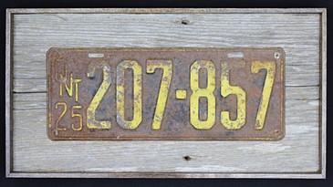 1925 ontario licence plate mounted on circa 1870s barnboard