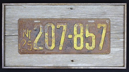 1925 ontario licence plate mounted on circa 1870s barnboard
