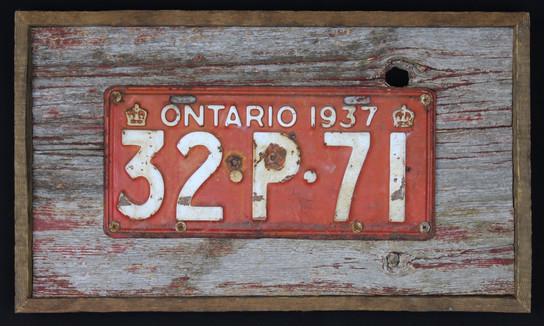 vintage 1937 Ontario licence plate mounted on circa 1870s barnboard