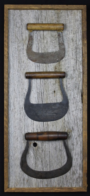 antique food choppers mounted on circa 1870s barnboard