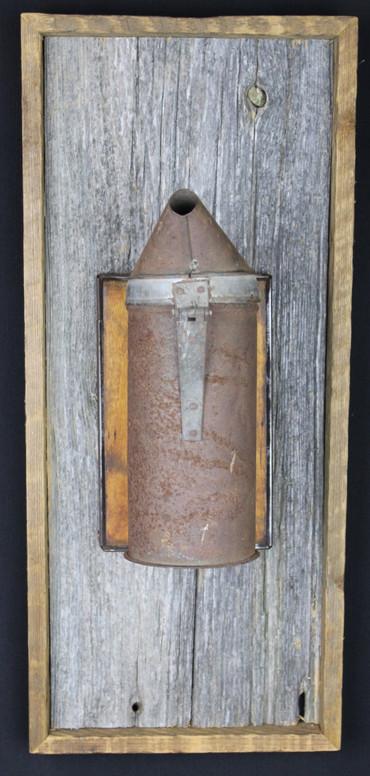 antique bee smoker mounted on circa 1870s barnboard