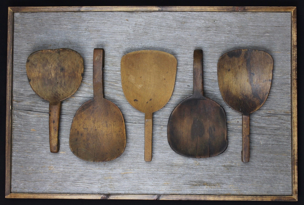 antique butter paddles mounted on extra wide circa 1870s barnboard