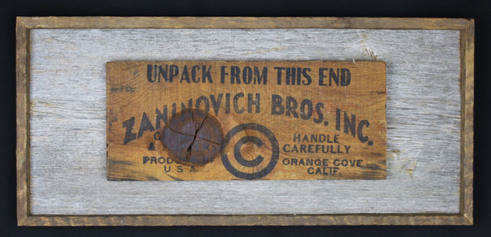 vintage shipping crate label mounted on circa 1870s barnboard