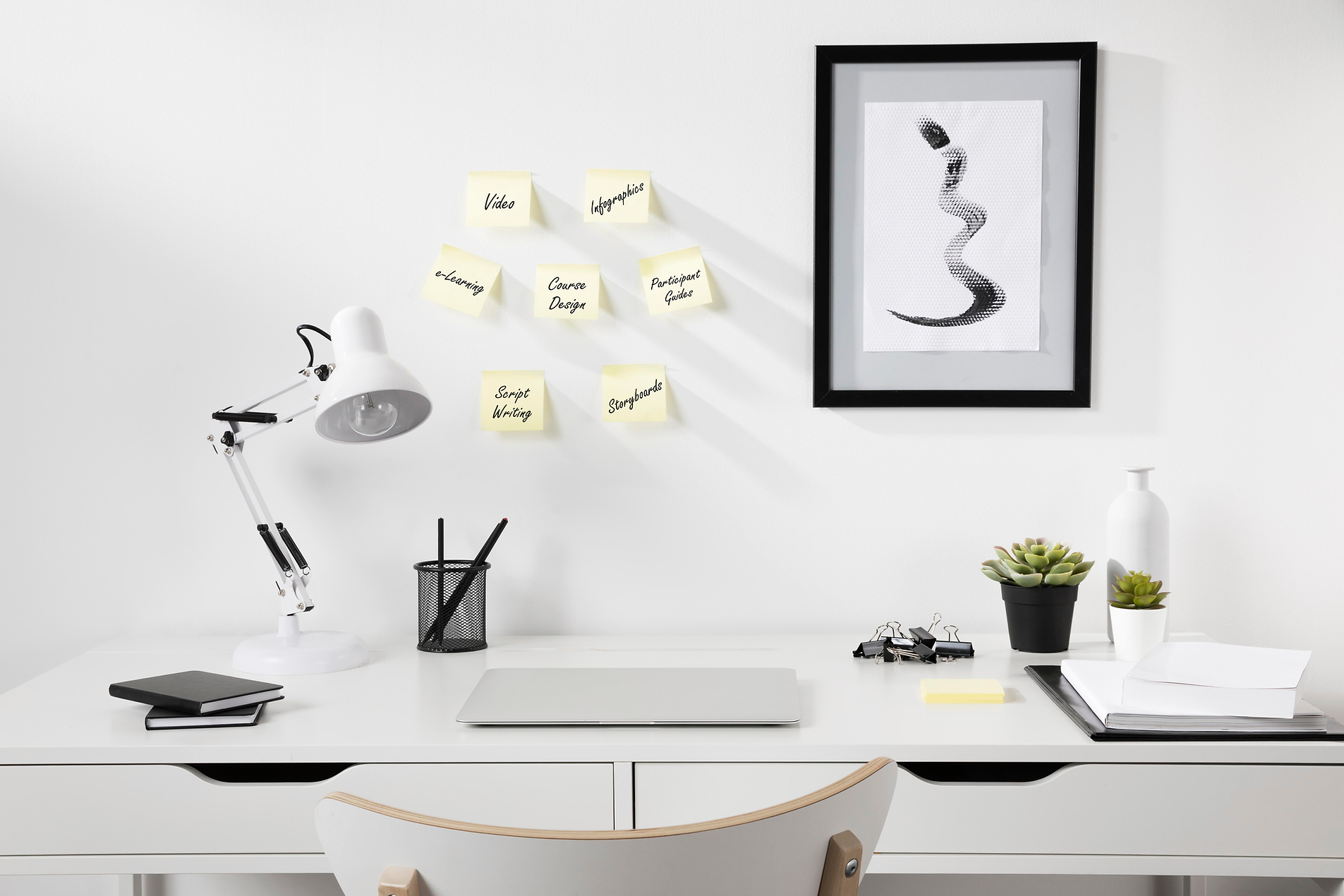 Neat organized workspace with post its d