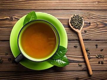 AN79-Green_tea_on_wood-732x549-Thumb_0.j