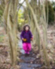 Child walking through wishing willow tun