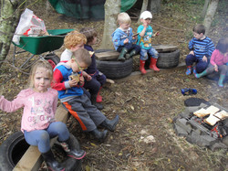 Toasting bread on campfire at children's nursery West Lothian