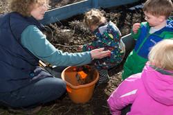 Children gardening at outdoor nursery