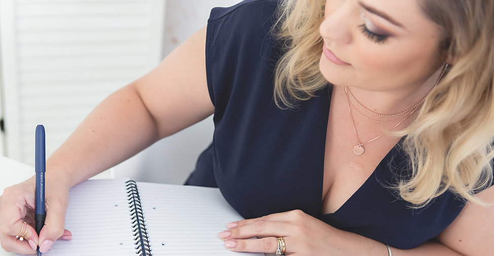 Jo Wood writing her bookkeeping course
