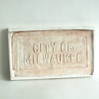 Reproduction of Sewer Cap Text
