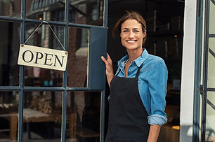 woman-at-small-business-entrance-EZ6X4CP